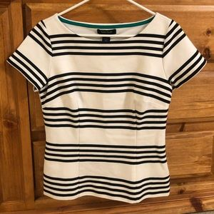 White barn peplum black and white striped top